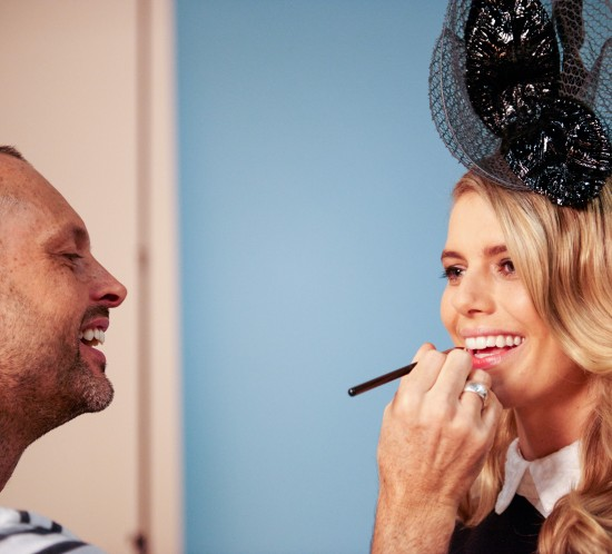 Hair & makeup artist Erin puts the finishing touches on model Kelly D.