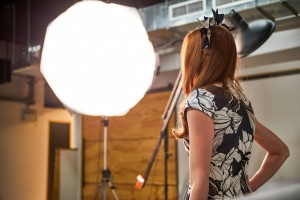 Model Kelly Z faces the bright lights on set.
